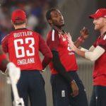 AHMEDABAD, INDIA - MARCH 12: Jofra Archer of England celebrates after taking the wicket of KL Rahul of India with team mate Ben Stokes (R) during the 1st T20 International match between India and England at Sardar Patel Stadium on March 12, 2021 in Ahmedabad, India. (Photo by Surjeet Yadav/Getty Images)